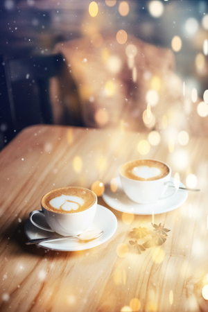 Christmas background with two cups of coffee, valentines day. Happy new year.