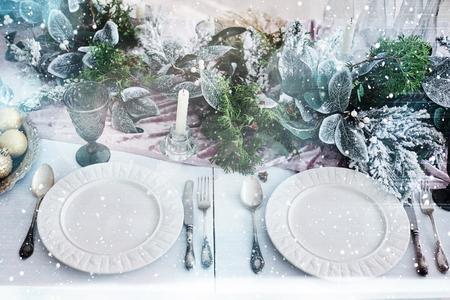 Table served for Christmas dinner in living room, top view. Bokeh light soft effect. Foto de archivo