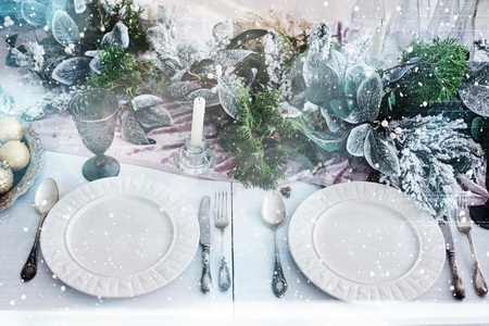 Table served for Christmas dinner in living room, top view. Bokeh light soft effect. Archivio Fotografico