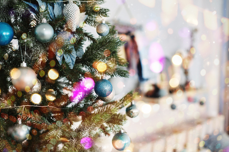 Close up of colorful ornaments on Christmas tree. Happy New Year and Christmas. Bokeh light soft effect. Фото со стока