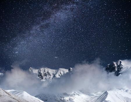 Fantastic starry sky. Thick fog on the mountain pass Goulet. Georgia, Svaneti. Europe. Caucasus mountains.