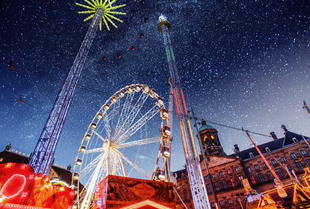 amusement park at the center of Amsterdam at night. Beautiful starry sky.