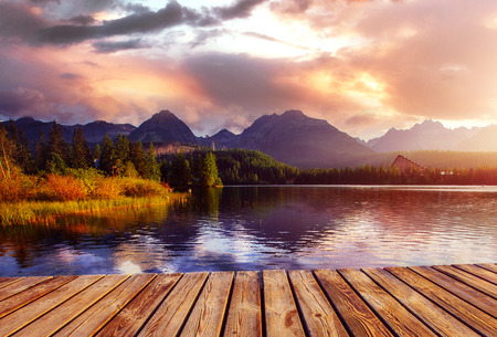 The sunrise over a lake in the park High Tatras. Shtrbske Pleso, Slovakia, Europe. Reklamní fotografie
