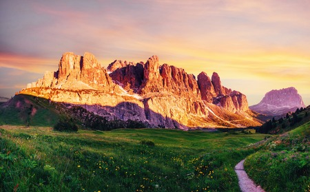 Dolomites landscape with mountain road. Rocky Mountains at sunset. Alps, Italy Standard-Bild