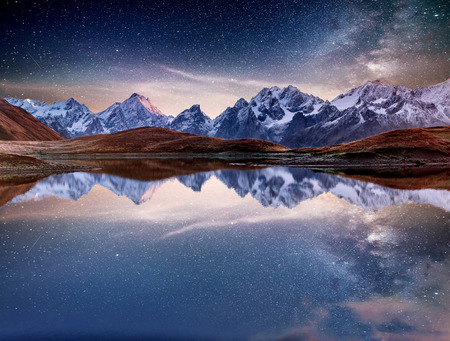 Fantastic starry sky on mountain lake Koruldi. Picturesque night Upper Svaneti, Georgia Europe. Caucasus mountains.