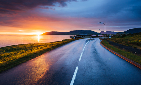 Lake sunrise and Beautiful road view at sunset. Iceland
