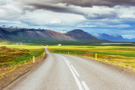 Asphalt road to the mountains Iceland. Beauty world. Stock Photo