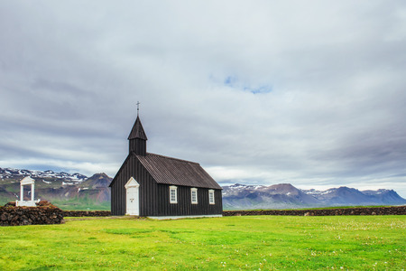 Mountain View Iceland. Beautiful black wooden church in Budir.