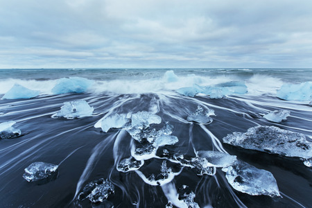 Jokulsarlon glacier lagoon, fantastic sunset on the black beach, Iceland. Stock Photo