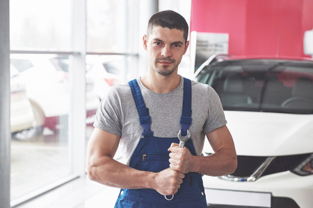 Hand of car mechanic with wrench. Auto repair garage. Stok Fotoğraf