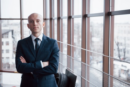Portrait of smiling young businessman in office.