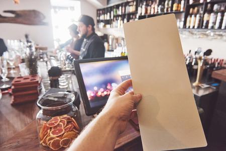 Mock up Menu frame on Table in Bar restaurant cafe Background. 스톡 콘텐츠