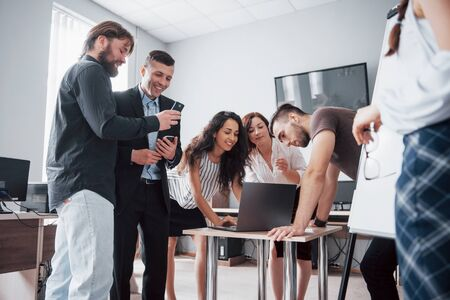 Portrait of creative team talking in office on meeting