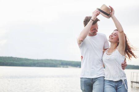 Loving funny playful happy couple on the beach Zdjęcie Seryjne