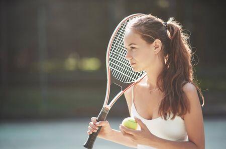 A beautiful woman wearing a sportswear tennis ball