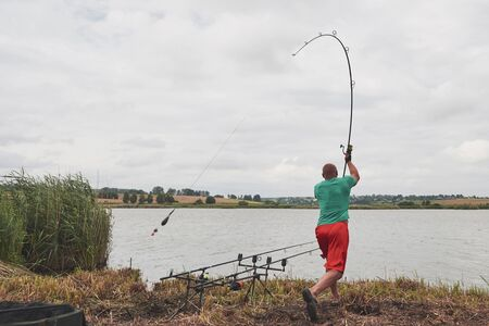 The fisherman throws a bait with bait. Today he will catch a big fish. Hunting and hobby sport.
