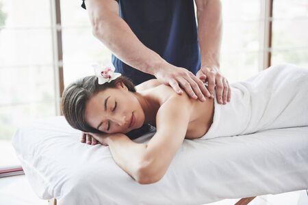 Beautiful woman lying on massage table in Spa