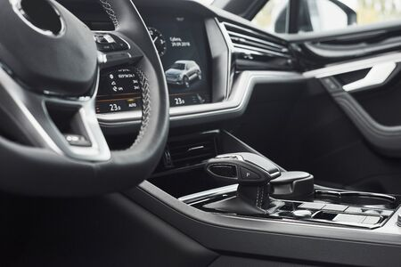 Interior of a prestigious modern black car. Leather comfortable seats and accessories and steering wheel.