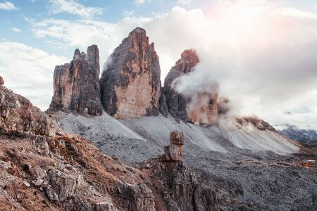 Majestic power of nature. Mountains in the fog and clouds. Tre Cime di Lavaredo.