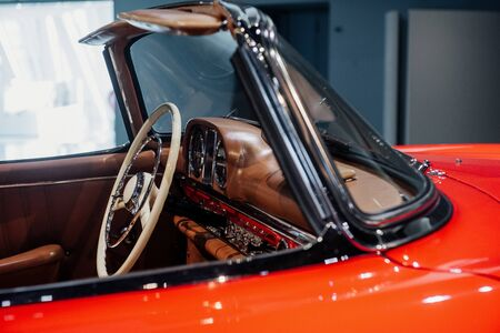 Photo from the side. Take a look closer. Inside of expencive collectible vintage car.