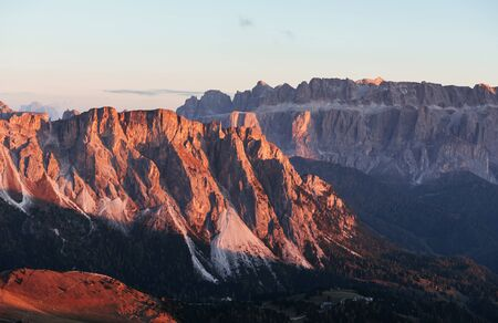 Orange hills. Landscape of mountains and trees below at sunny day. Italian Seceda alpes. Banco de Imagens