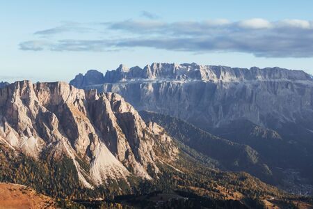 Landscape of mountains and trees below at sunny day. Italian Seceda alpes.