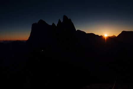 Sunset creates minimum of visibility. Evening at the Seceda dolomites.