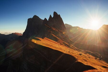 Piece and quiet. Beautiful sunset in the Italian majestic Seceda dolomite mountains.