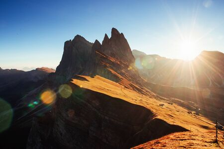 Hills is on the light. Beautiful sunset in the Italian majestic Seceda dolomite mountains.