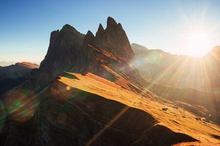 Beautiful sunset in the Italian majestic Seceda dolomite mountains.