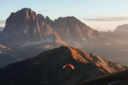 Extremal paragliding over the Seceda mountains in the Italy.