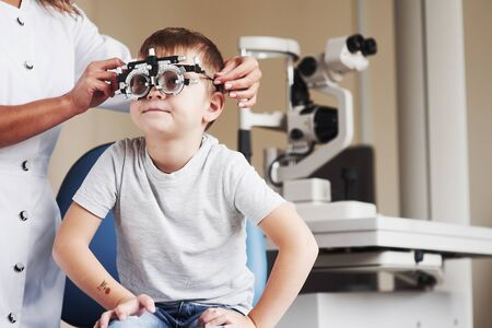 Now tell me how it looks. Child sitting in the doctors cabinet and have tested his visual acuity.