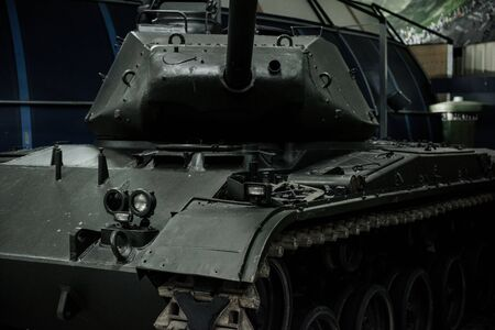 SINSHEIM, GERMANY - OCTOBER 16, 2018: Technik Museum. Cannon turned to the camera. Powerful old black tank at the exhibition.