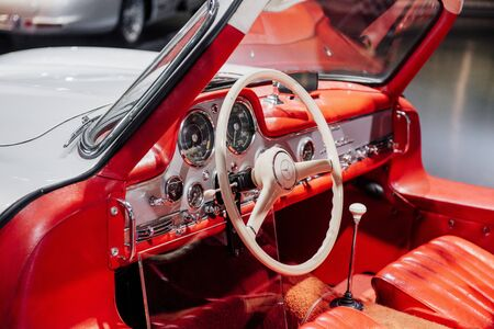 STUTTGART, GERMANY - OCTOBER 16, 2018: Mercedes Museum. White steering wheel and red interior. Inside of expencive collectible vintage car.