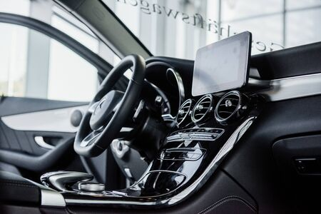 STUTTGART, GERMANY - OCTOBER 16, 2018: Mercedes Museum. The tablet near the steering wheel. Inside of brand new car with black interior. Redactioneel