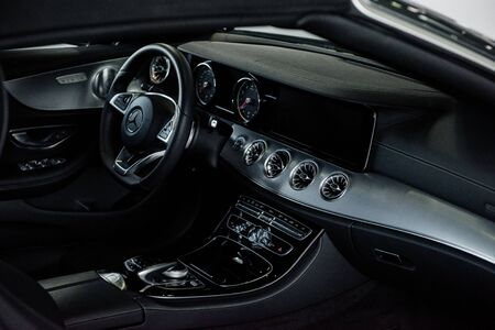 STUTTGART, GERMANY - OCTOBER 16, 2018: Mercedes Museum. Quality materials. Inside of brand new car with black interior.