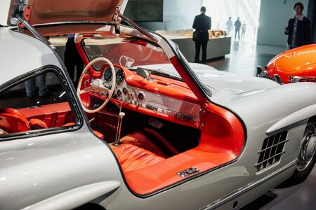 STUTTGART, GERMANY - OCTOBER 16, 2018: Mercedes Museum. People walks in the hall. Inside of expencive collectible vintage car.