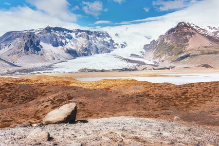 Valley National Park Landmannalaugar. On the gentle slopes of the mountains are snow fields and glaciers. Magnificent Iceland in the July.