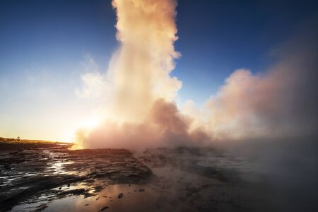Fantastic sunset Strokkur geyser eruption in Iceland. Fantastic colors. Stock fotó