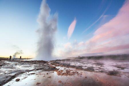 Fantastic sunset Strokkur geyser eruption in Iceland. Fantastic colors. 版權商用圖片