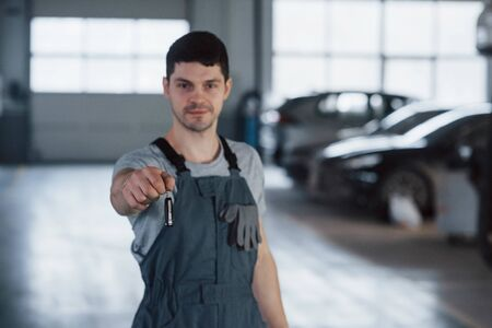 Your welcome. Hand of mechanic with keys. Your car is on the way again. Job well done. Stock fotó