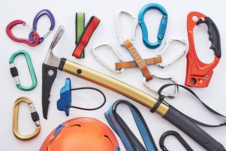Many of the objects. Top view. Climbing equipment for the safeness lying on the white table. Conception of extreme sports. Standard-Bild