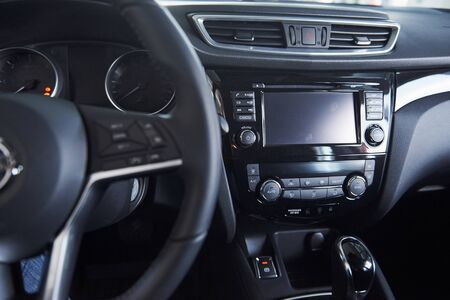 Luxury interior. Front part of the new expensive modern car that captured inside.