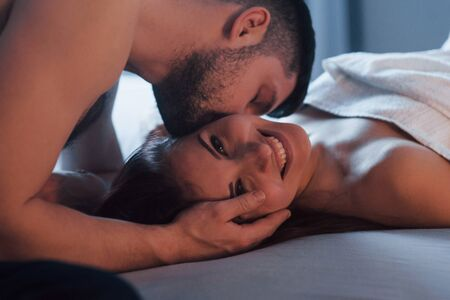 Gorgeous people. Sexy couple lying on the bed and enjoying themselves at morning time.