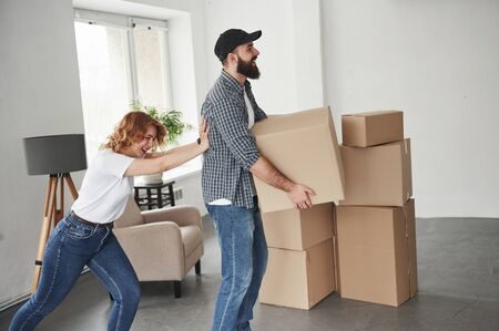 Just having fun. Happy couple together in their new house. Conception of moving.