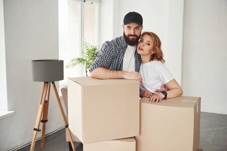 Nice portrait. Happy couple together in their new house. Conception of moving.