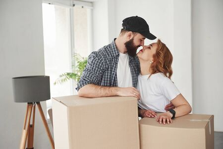 You are awesome. Happy couple together in their new house. Conception of moving.