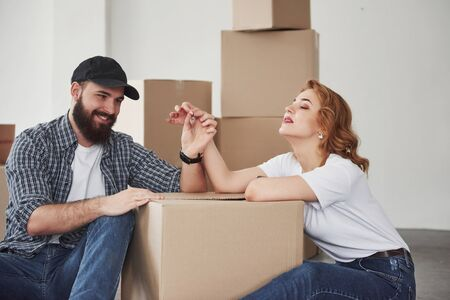 Enjoying the moment. Happy couple together in their new house. Conception of moving. Stock Photo