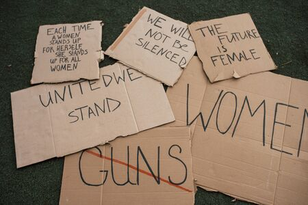 Group of banners with different feminist quotes lying on the ground. Stok Fotoğraf