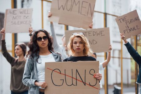 Six people. Group of feminist women have protest for their rights outdoors.
